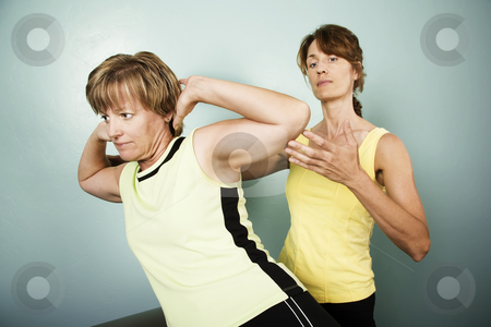 Workout with a Personal Trainer stock photo, Personal Trainer Supervises a Woman Working Out by Scott Griessel