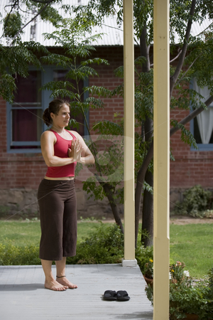 Yoga tree pose stock photo, Pretty Young Woman doing Yoga on a Porch by Scott Griessel