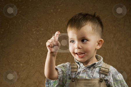 Young Arabic Boy stock photo, Portrait of a Happy Young Arabic boy Looking at his Finger by Scott Griessel