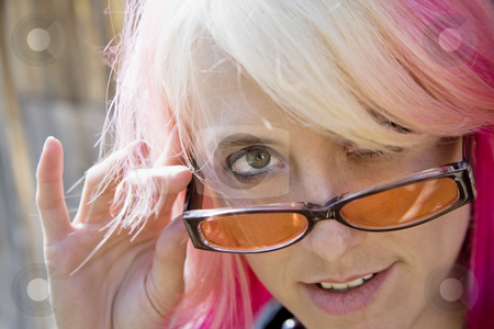 Woman Looking Over Her Glasses stock photo, Pretty Young Woman with Brightly Colored Hair Looking Over the Top of her Sunglasses by Scott Griessel