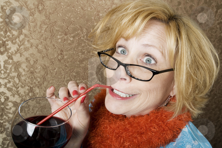Crazy Woman Drinking Wine stock photo, Crazy woman with wild eyes drinking wine through a straw by Scott Griessel