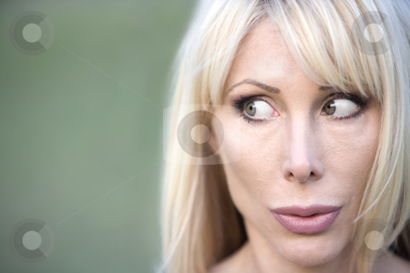 Beautiful Woman stock photo, Closeup of a beautiful woman looking to the left by Scott Griessel