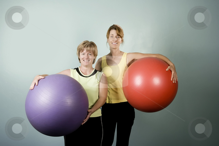 Women Posing With Exercise Balls stock photo, Two Physically Fit Women Posing With Exercise Balls by Scott Griessel