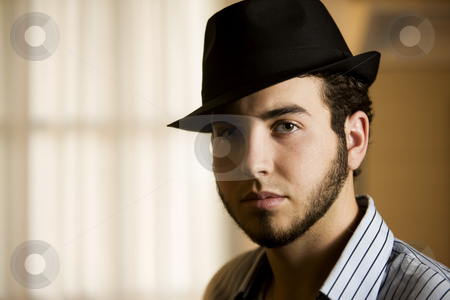 Young Man in a Fedora stock photo, Handsome Young Man Indoors Wearing a Fedora Hat by Scott Griessel