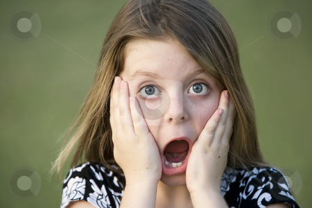 Pretty Young Girl with a Shocked Expression stock photo, Pretty Young Girl with Freckles and a Shocked Expression by Scott Griessel