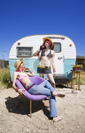 Young Women in Front of a Trailer stock photo, Two Young Punk Women in Front of a Trailer by Scott Griessel