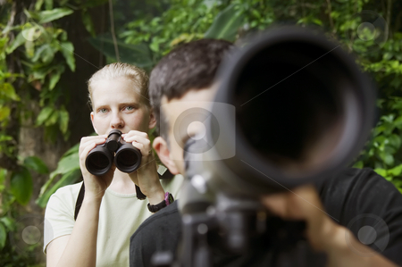 Pretty Woman with Binoculars and Man with Telescope in Jungle stock photo, Pretty Woman with Binoculars and Man with Telescope in Rain Forest Jungle by Scott Griessel