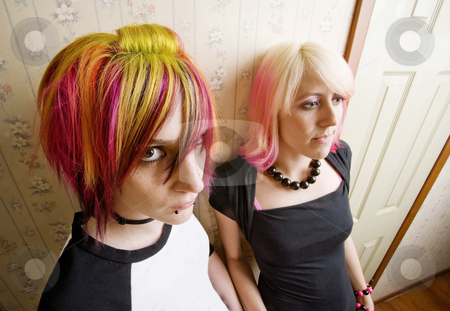 Women in a Hallway stock photo, Women in colorful hair leaning a wall in a hallway by Scott Griessel