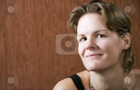 Woman Looking at Camera stock photo, Woman wering a necklace looking at the camera by Scott Griessel