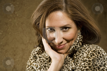 Smiling Hispanic Woman  stock photo, Hispanic Woman in Leopard Print Coat with Big Hair by Scott Griessel
