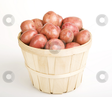 Red Potatoes stock photo, Red Potatoes gathered in a Woven Basket by Scott Griessel