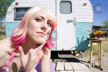 Woman in front of Travel Trailer stock photo, Pretty Woman Front of a Vintage Travel Trailer by Scott Griessel