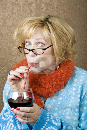Funny Woman Drinking Wine stock photo, Funny woman drinking wine through a straw by Scott Griessel