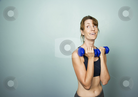Woman with Dumbbells stock photo, Pretty athletic woman with dumbbells and copy space by Scott Griessel