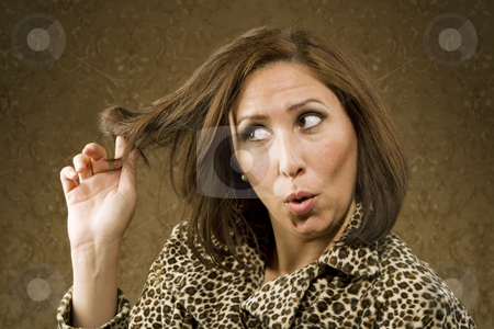 Hispanic Woman Twists her Hair stock photo, Hispanic Woman in Leopard Print Coat with Big Hair by Scott Griessel