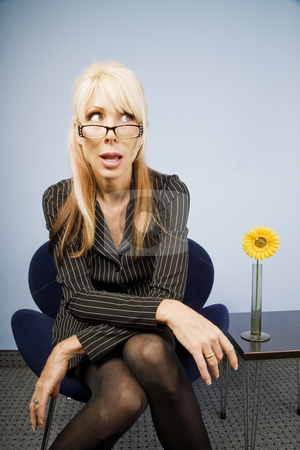 Woman Looking Over Her Glasses stock photo, Businesswoman looking over the top of her glasses by Scott Griessel