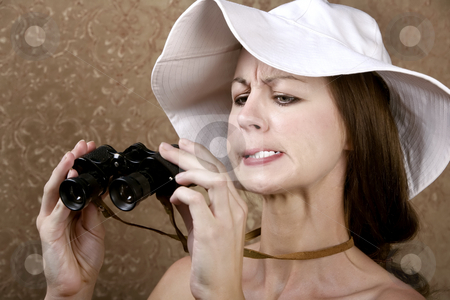 Woman with Sunglasses and Binoculars stock photo, Young Woman with Sunglasses and a Floppy White Hat Looking through the Wrong End of Binoculars by Scott Griessel