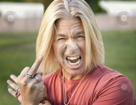 Rock and Roll Guy with his Middle Finger Extended stock photo, Rock and Roll Guy Making a Rude Gesture by Scott Griessel