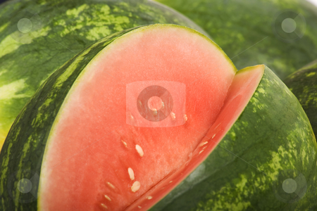 Watermelon stock photo, Bright red and green watermelon with a slice removed by Scott Griessel