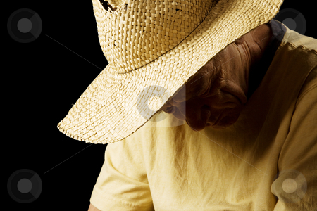 Sad man in a Straw Hat stock photo, Senior Man in a Straw Hat with his Head Down by Scott Griessel