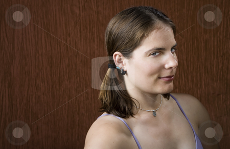 Woman with blue eyes  stock photo, Closeup of woman with blue eyes wearing pigtails by Scott Griessel