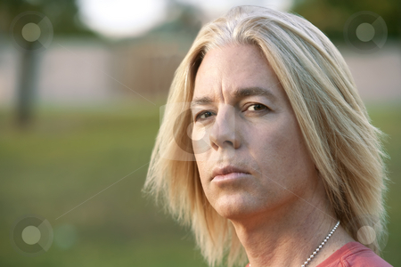 Rock and Roll Guy stock photo, Youthful adult male with long blonde hair by Scott Griessel
