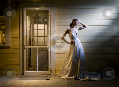 Bride on Back Porch stock photo, Tall Young Bride Alone on Back Porch by Scott Griessel