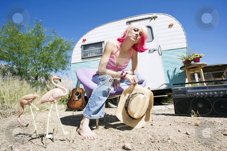 Woman in front of Travel Trailer stock photo, Pretty Woman in a Cowboy Hat in Front of a Travel Trailer by Scott Griessel