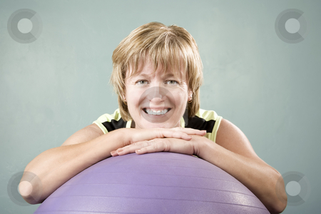 Woman Leaning on an Exercise Ball stock photo, Portrait of a Pretty Woman Leaning on an Exercise Ball by Scott Griessel