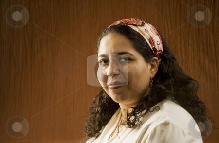 Arabic Woman stock photo, Portrait of a Muslim Woman in a Long Curly Black Hair by Scott Griessel