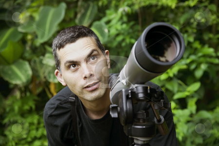Handsome Nature Guide stock photo, Handsome nature guide with a telescope in the rainforest by Scott Griessel