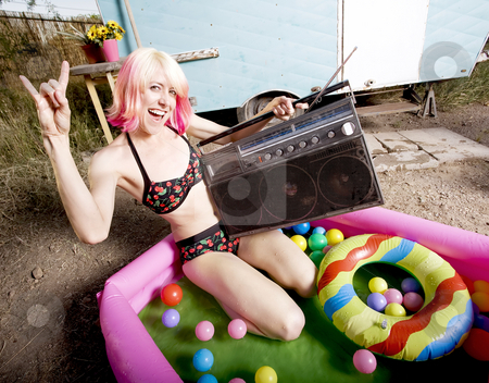 Rock and Roll Woman in a Play Pool stock photo, Woman with a boom box in an inflatable play pool by Scott Griessel