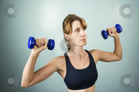Woman with Dumbbells stock photo, Pretty athletic woman working out with dumbbells by Scott Griessel