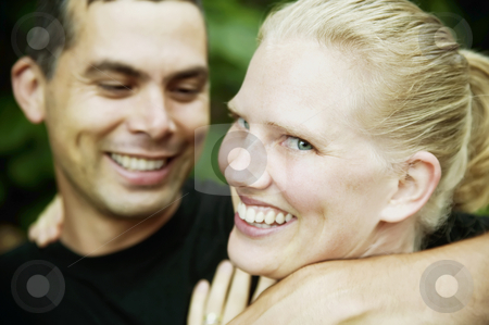 Hispanic Man and Blonde Woman stock photo, Handsome Hispanic Man and Pretty Blonde Woman by Scott Griessel