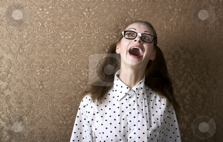 Nerdy Girl stock photo, Cute Nerdy Girl Leaning Against a Wall Laughing by Scott Griessel
