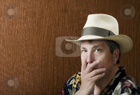 Man with his hand in front of hise face stock photo, Portrait of a Man in a Flowerd Shirt with his Hand in Front of his face by Scott Griessel