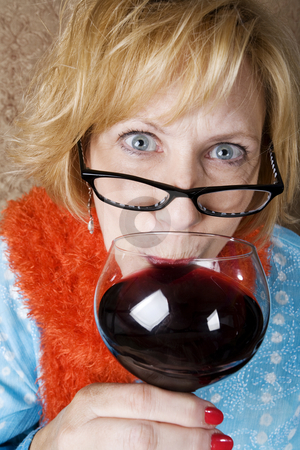 Crazy Woman Drinking Wine stock photo, Crazy woman with wild eyes drinking wine by Scott Griessel