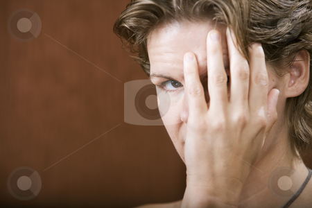 Woman Covering Her Face stock photo, Portrait of a shy woman hiding her face by Scott Griessel