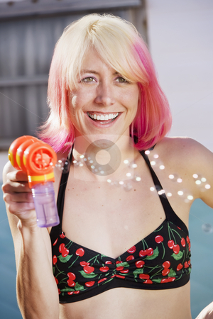 Woman with a Bubble Gun stock photo, Woman in bikini with a bubble gun by Scott Griessel