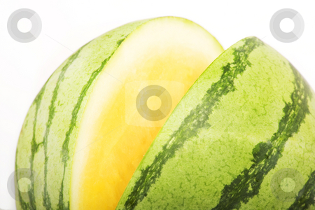 Yellow Watermelon stock photo, Bright yellow and green watermelon on a white background by Scott Griessel