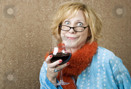Funny Woman Drinking Wine stock photo, Woman with a big grin drinking red wine by Scott Griessel