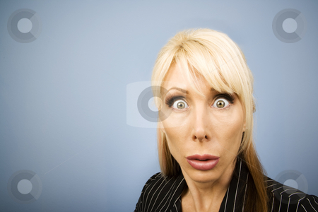 Businesswoman making a funny face stock photo, Businesswoman in a pinstripe suit making a funny face by Scott Griessel