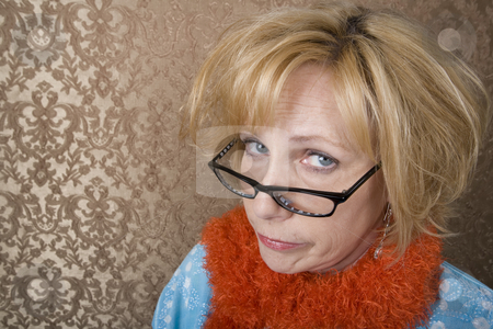 Crazy Woman  stock photo, Crazy woman with glasses suspiciouly eyeing the camera by Scott Griessel