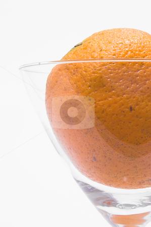 Orange in a Martini Glass stock photo, A fresh orange in a martini glass. by Robert Byron