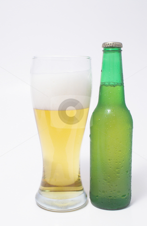 Beer stock photo, A pilsner glass of beer and a beer in a bottle. by Robert Byron