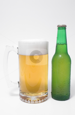 Beer stock photo, A mug of ice cold beer and a beer in a bottle. by Robert Byron