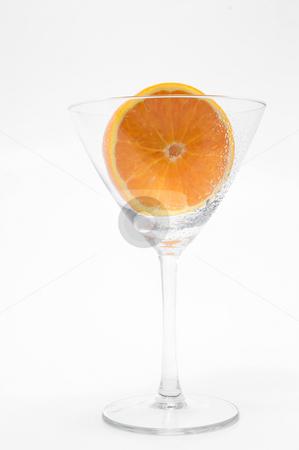 Sliced Orange in a Martini Glass stock photo, A freshly sliced orange in a martini glass. by Robert Byron