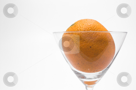 Orange in a Martini Glass stock photo, A fresh orange in a martini glass. by Robert Byron