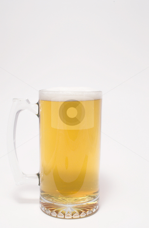 Beer stock photo, A glass mug of ice cold beer. by Robert Byron