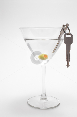 Car Keys in Martini stock photo, Concept: Drinking and driving don't mix. by Robert Byron